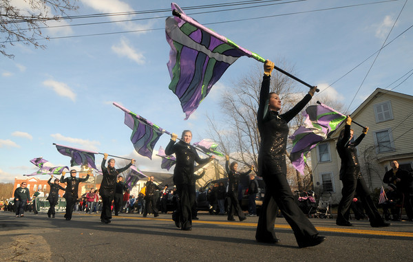 Merrimac: The Pentucket Marching band flags twirl their way down Main Street in the annual Merrimac Santa Parade Sunday afternoon. Jim Vaiknoras/staff photo