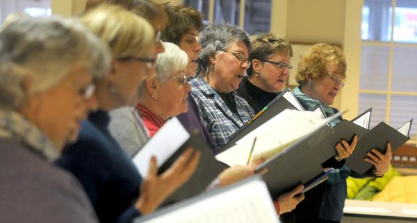Newburyport:The First Religious candlelight  choir rehearses