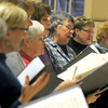 Newburyport:The First Religious candlelight  choir rehearses