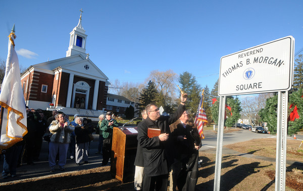 Salisbury: Fr. Louis Palmieri blesses a sign marking the newly named Reverend Thomas Morgan the former priest at the Star of the Sea Chruch. Jim Vaiknoras/staff photo