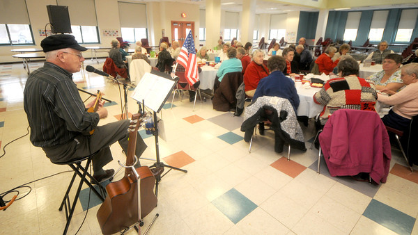 Newbury: Seniors enjoy the song stylings of Bruce Andrews at th Friends of the Newbury Council on Aging Holiday Luncheon at the Newbury Elementary School Friday. Jim Vaiknoras/staff photo
