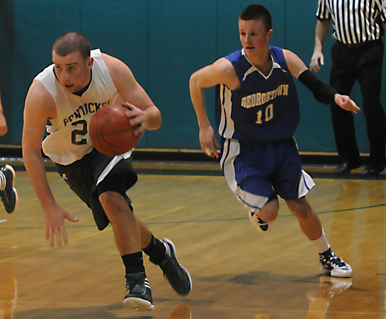 West Newbury: Pentucket's Nolan Dragon brings teh ball up past Georgetown's Tyler Wade in the River Rival Boys Basketball Tournament Final at Pentuckey Friday night. Jim Vaiknoras/staff photo