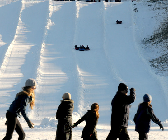 Amesbury: Sledders enjoy the only snow in the area, man made snow at Amesbury Sport Park. staff photo