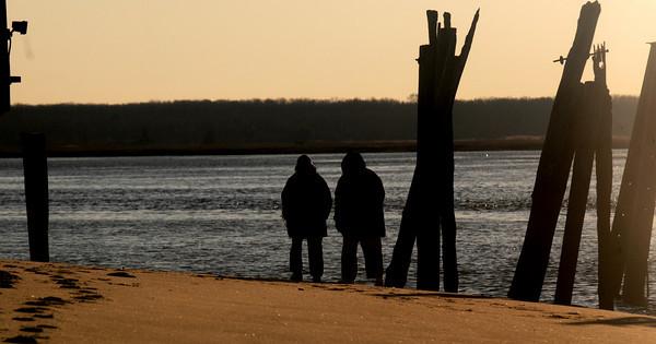 Newburyport: Mary and John Petrow walk along Plum Island Point at sunset Saturday afternoon.Staff photo