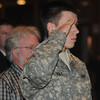Amesbury; Private Brian Holt salutes during the playing of the National anthem at the 11th annual Support the Troops Christmas Dinner at the Holy Family Parish Hall in Amesbury. Jim Vaiknoras/staff photo