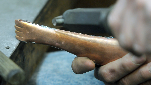 Seabrook: Coppersmith Don Felix solders 2 pieces of copper at his Seabrook workshop. Jim Vaiknoras/staff photo
