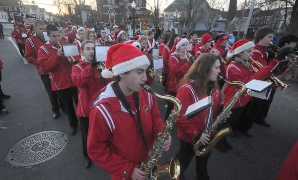 Amesbury: The Amesbury high school band performs during Saturday's Amesbury Christmas Parade. Jim Vaiknoras/staff photo