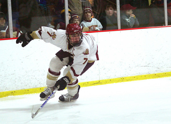 Newburyport: Newburyport's Gaven LaValley (7) keeps an eye on the Danvers defense as he chases down a loose puck during Tuesday night's game at the Graf Rink. Photo by Ben Laing/Staff Photo