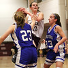 Newburyport: Beth Castantini (10) of Newburyport tries to split two Georgetown defenders during Tuesday night's game at Newburyport High. Photo by Ben Laing/Staff Photo