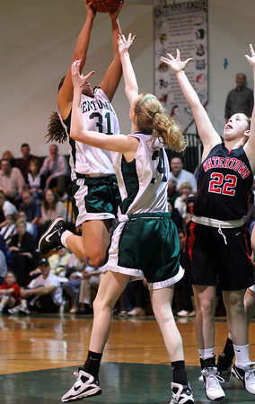 West Newbury: Sarah Higgins (31) and Vanessa Cahill (34) of Pentucket leap for a rebound during Monday night's game against Watertown. Photo by Ben Laing/Staff Photo