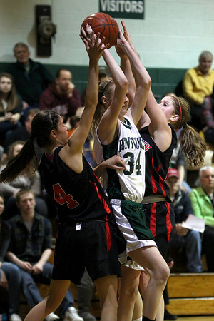 West Newbury: Vanessa Cahill (34) of Pentucket is swarmed by a pair of Watertown players during Monday night's game in West Newbury. Photo by Ben Laing/Staff Photo