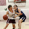 Newburyport: Newburyport's Ally Leahy (44) drives past Triton's Courtney Blatti (2) during Tuesday night's game at Newburyport High School. Photo by Ben Laing/Staff Photo