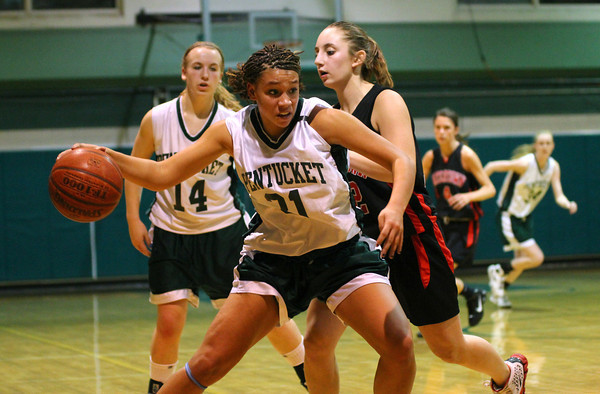 West Newbury: Pentucket's Sarah Higgins (31) drives towards the hoop during Monday night's game against Watertown in West Newbury. Photo by Ben Laing/Staff Photo