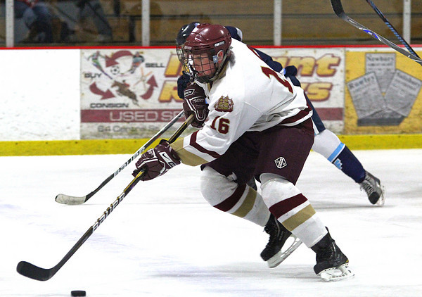 Newburyport: Newburyport's Dominic Ferreira (16) skates the puck up the ice Wednesday night as the Clippers hosted Divison 2 South powerhouse Franklin. Photo by Ben Laing/Staff Photo