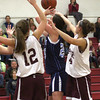 Newburyport: Triton's Laura Mills (25) is swarmed by Newburyport's Molly Rowe (12) and Cady Bennett (14) during Tuesday night's game in Newburyport. Photo by Ben Laing/Staff Photo