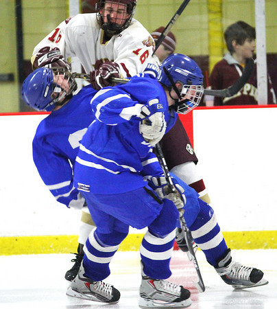 Newburyport: Newburyport's Dom Ferreira (16) lays a massive open ice hit on a Danvers player during Tuesday night's game at the Graf Rink. Photo by Ben Laing/Staff Photo