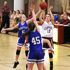 Newburyport: Molly Rowe (12) of Newburyport has her shot blocked by Georgetown's Michelle Reilly (5) during Tuesday night's game at Newburyport High School. Photo by Ben Laing/Staff Photo