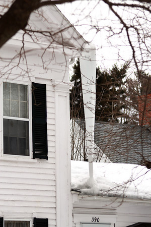 Amesbury: An enormous icicle hangs from the corner of a home on Main Street in Amesbury Monday afternoon. Photo by Ben Laing/Staff Photo