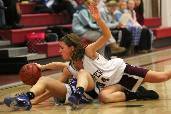 Newburyport: Newburyport's Aly Leahy (44) fights for a loose ball with a Georgetown player during Tuesday night's game at Newburyport High School. Photo by Ben Laing/Staff Photo