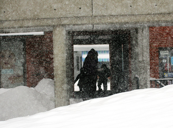 Newburyport: Shoppers in downtown Newburyport cut through the tunnels connecting State Street with Inn Street Tuesday as the area was hit by another big snow storm. Photo by Ben Laing/Staff Photo