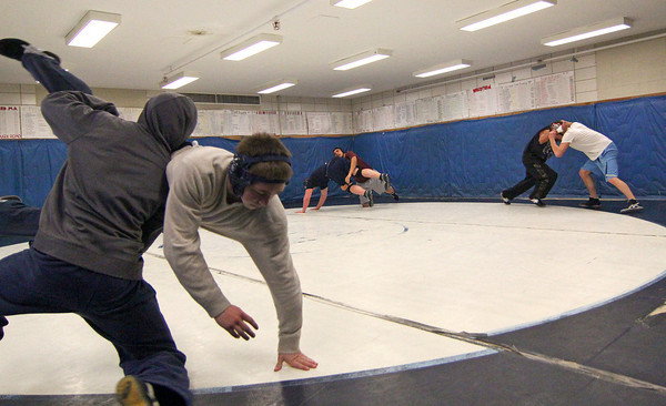 Byfield: The Trtion wrestling team practices Tuesday afternoon in preperation for their state title match agasint Holliston Wednesday night at Worcester Polytechnical Institute. Photo by Ben Laing/Staff Photo