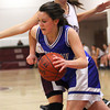 Newburyport: Georgetown's Rachel Sherman (14) slips past Newburyport's Molly Rowe (12) during Tuesday night's girls basketball game at Newburyport High. Photo by Ben Laing/Staff Photo