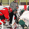 Newburyport: Amesbury's Zachary Pizzo (4) and Pentucket's Max Mangano (7) face off during Wednesday's 2-2 tie at the Graf Rink. Photo by Ben Laing/Staff Photo