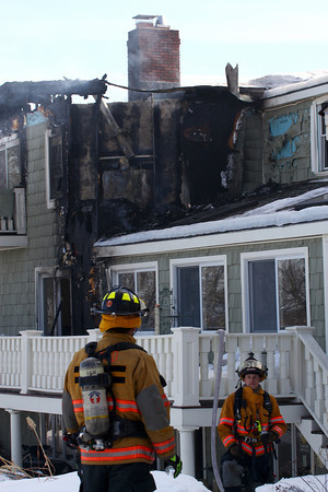 West Newbury: A fire damaged a portion of this home at 21 Montclair Road Wednesday afternoon, which is believe to have started when technicians were working on the homes gas fireplace. Photo by Ben Laing/Staff Photo