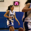 Georgetown: Kristen Hogan (11) of Georgetown brings the ball up the court Monday night against the Academy of Notre Dame. The two teams met in the first round of the state tournament. Photo by Ben Laing/Staff Photo