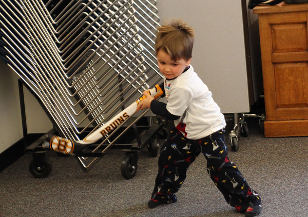 Newbury: Cameron McDonald, 3, of Newbury, takes a shot with a toy hockey stick during children's hour at the Newbury Public Library Tuesday afternoon. Photo by Ben Laing/Staff Photo