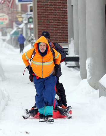 Newburyport: Caitlin Cray of Newburyport tows her kids up State Street Wednesday afternoon during the second snow storm in as many days. Photo by Ben Laing/Staff Photo