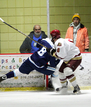 Newburyport: Newburyport's Connor Wile (6) lines up Franklin's Ian Shumway (8) for a hit during Wednesday night's game at the Graf Rink. Photo by Ben Laing/Staff Photo