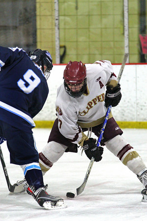 Newburyport: Gaven LaValley (7) of Newburyport wins a face off against Franklin's James Marchand (9) during Wednesday night's game at the Graf Rink. Photo by Ben Laing/Staff Photo