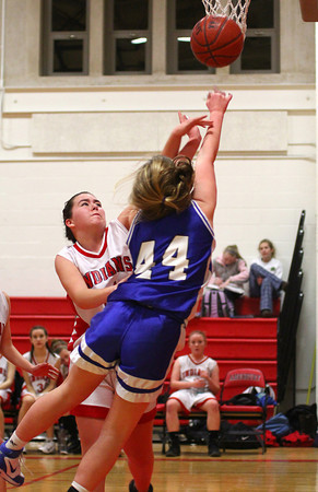 Amesbury: Amesbury's Morgan Sydlowski (21) defends a shot by Georgetown's Cally O'Connor (44) during Monday night's game. The visiting Royals would emerge victorious, defeating the Indians 67-59. Photo by Ben Laing/Staff Photo