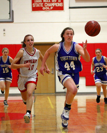 Amesbury: Georgetown's Cally O'Connor (44) chases down a loose ball while Amesbury's Emily Martin (10) races after her as the Royals defeated the Indians 67-59 Monday night. Photo by Ben Laing/Staff Photo