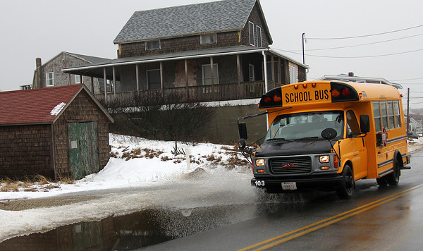 Newbury: A school bus drives through a large puddle along Northern Blvd. on Plum Island Monday afternoon. With the rain and warm temperatures melting the snow, many areas have seen minor flooding. Photo by Ben Laing/Staff Photo