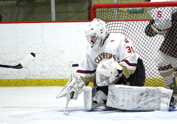Newburyport: Newburyport goalie Alex Buckley (30) makes a save during Tuesday night's game against Danvers, which the Clippers won in a shootout. Photo by Ben Laing/Staff Photo