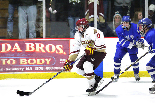 Newburyport: Newburyport's Nate Hickman (10) skates past a pair of Danvers defenders during Tuesday night's game at the Graf Rink. The two teams battled to a 3-3 tie before the Clippers won the game in a shoot out as part of the Newburyport Bank Tournament. Photo by Ben Laing/Staff Photo