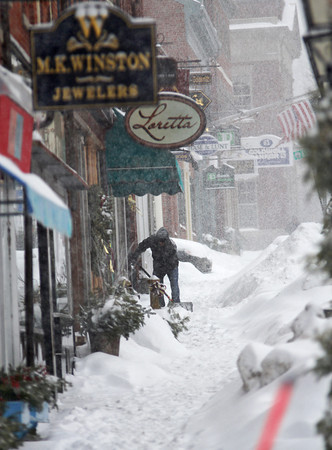 Newburyport: Tuesday's snow storm pounded the area as shopkeepers along State Street in Newburyport tried to keep up with shoveling. Photo by Ben Laing/Staff Photo