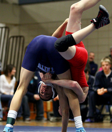 Byfield: Triton's Victor Ramirez can't shake Hingham's Charlie Ward off his back during Wednesday's Division III State Semi-Final match in Byfield. Photo by Ben Laing/Staff Photo