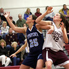 Newburyport: The Clippers Sam Leahy (32) and Trtion's Laura Mills (25) battle for position during Tuesday night's game in Newburyport. Photo by Ben Laing/Staff Photo