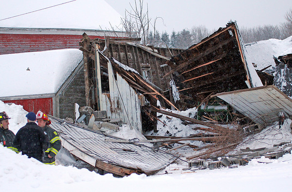 Newbury: A building collapsed at the Sunshine Dairy Farm on High Road in Newbury Wednesday afternoon, after heavy snow fall piled up over the past two days. Photo By Ben Laing/Staff Photo