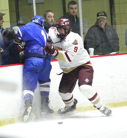 Newburyport: Kris Holmes (9) of Newburyport checks Danvers' Nick Strangie (15) during Tuesday nights game at the Graf Rink. The Clippers won the game in a shoot out as part of the Newburyport Bank Tournament. Photo by Ben Laing/Staff Photo