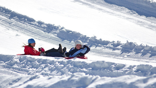 Amesbury: A pair of tubers head down the slopes at Amesbury Sports Park Tuesday afternoon. With school vacation running this week, the Park is a popular spot for parents and kids looking to get outdoors. Photo by Ben Laing/Staff Photo