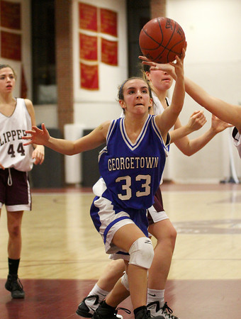 Newburyport: Georgetown's Marisa Agganis (33) stretches out to save a loose ball during Tuesday night's game at Newburyport. Photo by Ben Laing/Staff Photo
