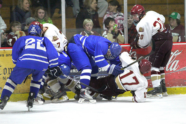 Newburyport: Newburyport and Danvers players get in a scrum over a loose puck during Tuesday nights game at the Graf Rink. Photo by Ben Laing/Staff Photo