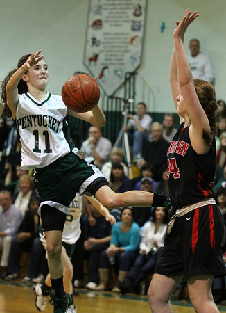 Pentucket: Alex Moore (11) of Pentucket is fouled on her way to the basket during Monday night's game against Watertown. Photo by Ben Laing/Staff Photo