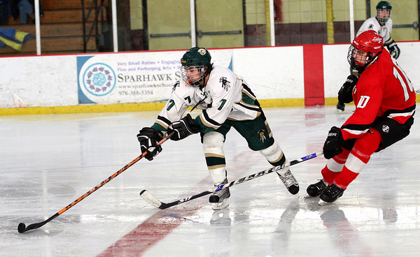 Newburyport: Max Mangano (7) of Pentucket dangles a puck just out of the reach of Amesbury's Garrett King (10) during Wednesday's 2-2 tie. Photo by Ben Laing/Staff Photo