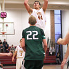 Newburyport: Newburyport's Eric Meyer (44) takes a jump shot over a Manchester-Essex defender during Wednesday afternoon's game. Photo by Ben Laing/Staff Photo