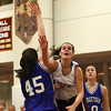 Newburyport: Beth Castantini (10) floats a shot over Georgetown's Ali Newbury (45) as the Clippers hosted the Royals Tuesday night. Photo by Ben Laing/Staff Photo